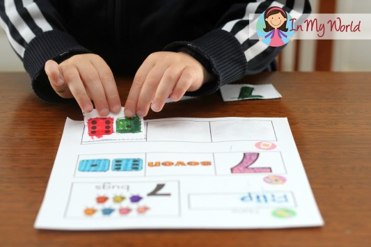 Preschool number 7 page - cut, paste and match the numeral, number word and number representation on dice. FREE printable.