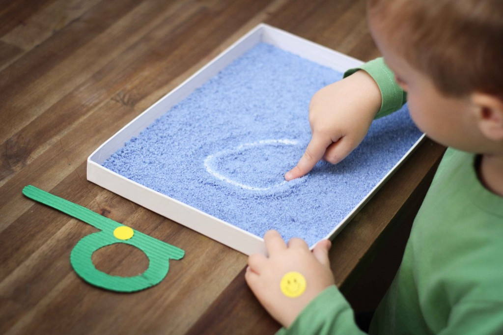 Preschool Letter of the Week D writing practice in salt tray