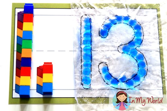 Number Play Dough Mat with unifix cubes to represent the number and hair gel and beads sensory bag
